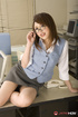 Office skank strips off her outfit at her desk at work.
