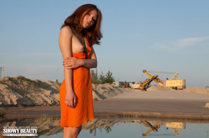 Glamorous belle in an orange dress shows her crack at the beach. - XXXonXXX - Pic 1