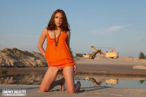 Glamorous belle in an orange dress shows her crack at the beach. - XXXonXXX - Pic 2