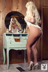 Blonde in a lacy white teddy gets naked in front of the dresser.