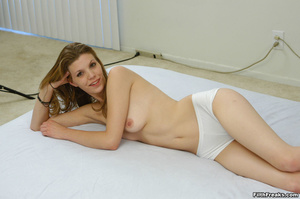 Naked,long-haired blonde with small swatch of pussy hair teases with slender body on large bed. - XXXonXXX - Pic 1