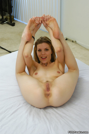 Naked,long-haired blonde with small swatch of pussy hair teases with slender body on large bed. - XXXonXXX - Pic 7