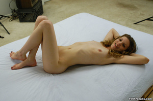Naked,long-haired blonde with small swatch of pussy hair teases with slender body on large bed. - XXXonXXX - Pic 8