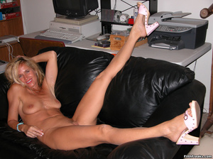Tan, blue-eyed blonde shows off perfect physique on a couch and red chair, smiling proudly. - XXXonXXX - Pic 10