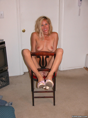 Tan, blue-eyed blonde shows off perfect physique on a couch and red chair, smiling proudly. - XXXonXXX - Pic 14