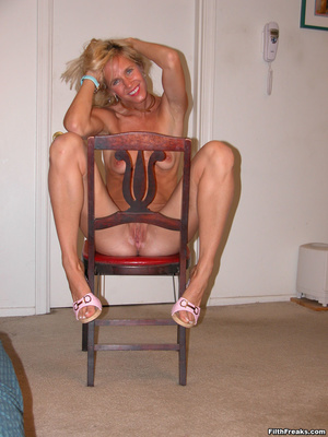 Tan, blue-eyed blonde shows off perfect physique on a couch and red chair, smiling proudly. - XXXonXXX - Pic 15