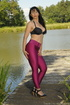 Sexy woman by a pond takes off her top to reveal…