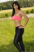 Horny MILF in a grassy area wears a hot pink tube…