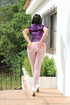 Lady unbuttons purple satin top and reaches into…