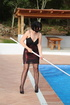 Girl takes off burgundy dress to clean pool in…