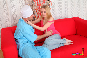 Excellent woman in a pink shirt and jeans gets the doc's dick up the rear on the red sofa. - XXXonXXX - Pic 6