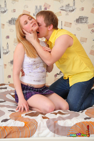 Knockout babe in a printed shirt and plaid skirt takes her lovers bone up the ass in bed. - XXXonXXX - Pic 3