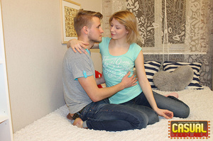 Wicked chick in a blue shirt and jeans rides a prick on white sheets. - XXXonXXX - Pic 2