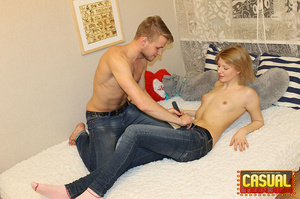 Wicked chick in a blue shirt and jeans rides a prick on white sheets. - XXXonXXX - Pic 6