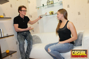 Enthralling diva in a black shirt and torn jeans does a nerd's cock on the sofa. - XXXonXXX - Pic 1