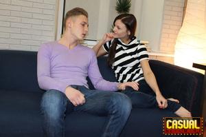 Marvelous senora in a striped shirt and blue jeans bounces on a boner on a blue sofa. - XXXonXXX - Pic 2