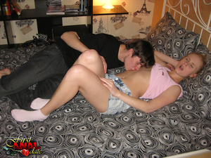 Welcoming harlot in a pink shirt and white socks gets a cock slipped in her ass in bed. - XXXonXXX - Pic 4