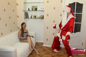 Brunette teeny in a ponytail gets her asshole slammed with Santa's thick dick - XXXonXXX - Pic 3