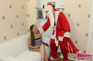 Brunette teeny in a ponytail gets her asshole slammed with Santa's thick dick - XXXonXXX - Pic 4