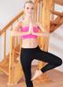 Two slim teen girls in leggings and tops enjoy yoga