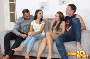 Two couples undress before testing the sturdiness of a couch in multi partner-switching positions. - XXXonXXX - Pic 1