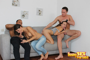 Two couples undress before testing the sturdiness of a couch in multi partner-switching positions. - XXXonXXX - Pic 9