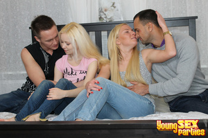 Two fair-skinned blondes with guys in their bed undress to pleasure both cocks with their juicy holes. - XXXonXXX - Pic 3