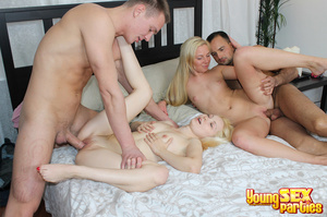 Two fair-skinned blondes with guys in their bed undress to pleasure both cocks with their juicy holes. - XXXonXXX - Pic 13