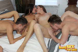 Two sluts enjoy kissing each other when being drilled from behind by two guys tag-teaming the girls. - XXXonXXX - Pic 12