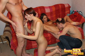 A red blanket thrown over a couch is the setting for four gorgeous youngsters having hardcore sex. - XXXonXXX - Pic 4