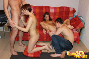 A red blanket thrown over a couch is the setting for four gorgeous youngsters having hardcore sex. - XXXonXXX - Pic 5
