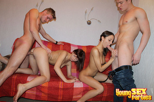 A red blanket thrown over a couch is the setting for four gorgeous youngsters having hardcore sex. - XXXonXXX - Pic 8