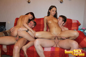 A red blanket thrown over a couch is the setting for four gorgeous youngsters having hardcore sex. - XXXonXXX - Pic 12