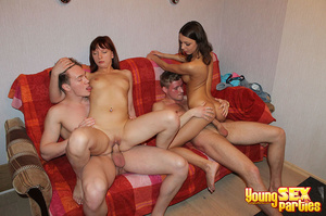 A red blanket thrown over a couch is the setting for four gorgeous youngsters having hardcore sex. - XXXonXXX - Pic 16