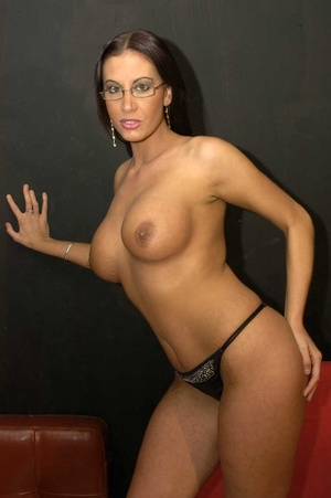 Hot brunette with glasses displays her alluring body wearing a black thong then she goes down and sucks a bunch of dicks before she let them squirt cum on her chest. - XXXonXXX - Pic 1