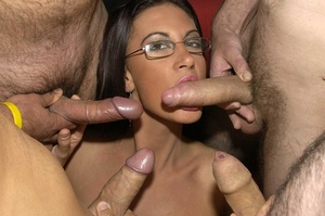 Hot brunette with glasses displays her alluring body wearing a black thong then she goes down and sucks a bunch of dicks before she let them squirt cum on her chest. - XXXonXXX - Pic 3