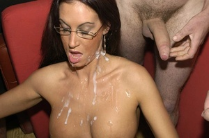 Hot brunette with glasses displays her alluring body wearing a black thong then she goes down and sucks a bunch of dicks before she let them squirt cum on her chest. - XXXonXXX - Pic 11