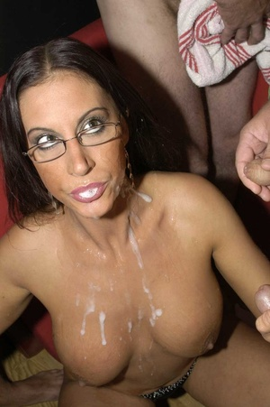 Hot brunette with glasses displays her alluring body wearing a black thong then she goes down and sucks a bunch of dicks before she let them squirt cum on her chest. - XXXonXXX - Pic 12