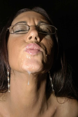 Hot brunette with glasses displays her alluring body wearing a black thong then she goes down and sucks a bunch of dicks before she let them squirt cum on her chest. - XXXonXXX - Pic 15