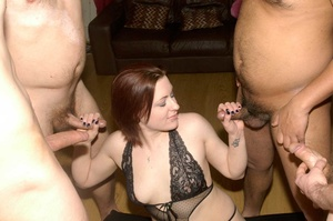 Hot redhead posing in black lingerie and fishnet stockings on a black matress grabs multiple dicks and sucks them then lets them spray jizz in her mouth. - XXXonXXX - Pic 6