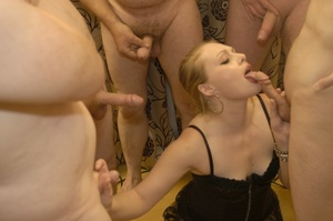 Gorgeous blonde in sexy black dress kneels down and sucks a group of dicks til they blow their spunk on her beautful face. - XXXonXXX - Pic 2