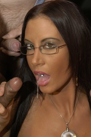 Luscious brunette with fine tits and hot body wearing glasses displays her pussy wearing black stockings with suspenders before she goes down and eats multiple dicks while she lets them cum in her mouth then she gets on a black couch and continues to suck them while letting some fuck her in different positions. - XXXonXXX - Pic 4