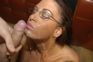 Luscious brunette with fine tits and hot body wearing glasses displays her pussy wearing black stockings with suspenders before she goes down and eats multiple dicks while she lets them cum in her mouth then she gets on a black couch and continues to suck them while letting some fuck her in different positions. - XXXonXXX - Pic 7