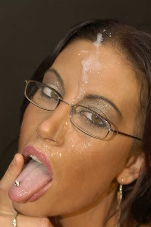 Luscious brunette with fine tits and hot body wearing glasses displays her pussy wearing black stockings with suspenders before she goes down and eats multiple dicks while she lets them cum in her mouth then she gets on a black couch and continues to suck them while letting some fuck her in different positions. - XXXonXXX - Pic 10