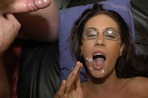 Luscious brunette with fine tits and hot body wearing glasses displays her pussy wearing black stockings with suspenders before she goes down and eats multiple dicks while she lets them cum in her mouth then she gets on a black couch and continues to suck them while letting some fuck her in different positions. - XXXonXXX - Pic 15