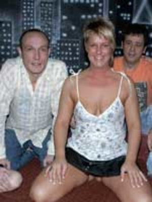 Hot MILF takes off her white and black spaghetti shirt and black skirt then joined by a couple of hot naked girls as they suck then ride on huge cocks on a maroon bed for a group sex party. - XXXonXXX - Pic 1