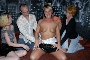 Hot MILF takes off her white and black spaghetti shirt and black skirt then joined by a couple of hot naked girls as they suck then ride on huge cocks on a maroon bed for a group sex party. - XXXonXXX - Pic 2