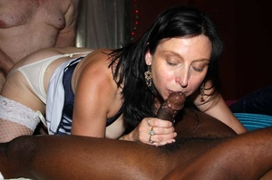 Sexy babe wearing blue and white stripe shirt and white stockings sucks a group of dicks while getting her ass and pussy fucked by interracial cocks til they blow jizz in her mouth on a cream bed. - XXXonXXX - Pic 3