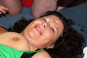 Mature babe in green blouse sucks a huge cock while getting her pussy eaten by another dude before she gets creamed on her face while another hot milf gets her pussy fucked by different dudes while sucking different dicks on a blue bed. - XXXonXXX - Pic 15