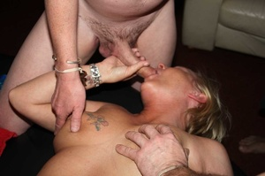 Tattooed blonde sucks a huge dick then takes off her flesh shirt and lets a group of guys fuck her while she sucks their cocks til she gets creamed on a black bed. - XXXonXXX - Pic 3